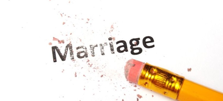 8656645 - divorce concept with marriage word pencil and eraser