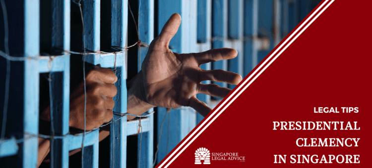 "Featured image for the ""Presidential clemency in Singapore"" article. It features a man holding on to blue prison bars with his left hand outstretched."
