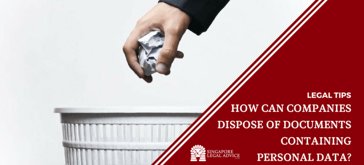 "Featured image for the ""How Can Companies Dispose of Documents Containing Personal Data?"" article. It features a hand holding a crumpled ball of paper over a wastepaper bin."