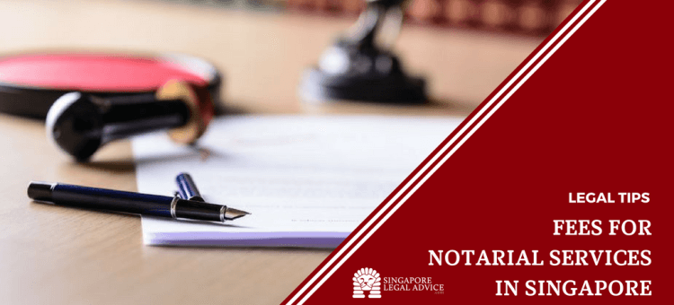 "Featured image for the ""Fees for Notarial Services in Singapore"" article. It features a writing pad, a pen and notary stamp."
