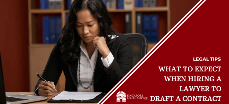 "Featured image for the ""What to Expect When Hiring a Lawyer to Draft a Contract"" article. It features a lawyer concentrating as she reviews a draft contract."