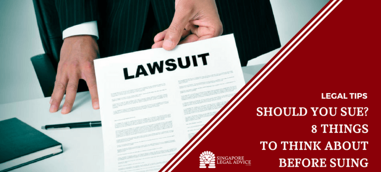 "Featured image for the ""Should You Sue? 8 Things to Think About Before Suing"" article. It features a lawyer serving court papers."