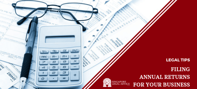 Calculator, pen and spectacles on top of annual returns forms