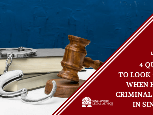 """Featured image for the """"4 Qualities to Look Out For When Hiring a Criminal Lawyer in Singapore"""" article. It features law books, handcuffs, and a gavel."""