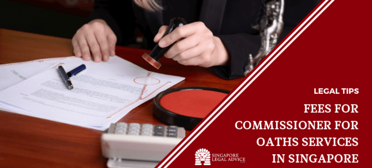 "Featured image for ""Fees for Commissioner for Oaths Services in Singapore"" article. It features a hand stamping a legal document."