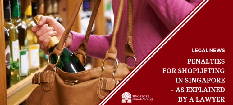 Woman in a store putting a wine bottle in her handbag