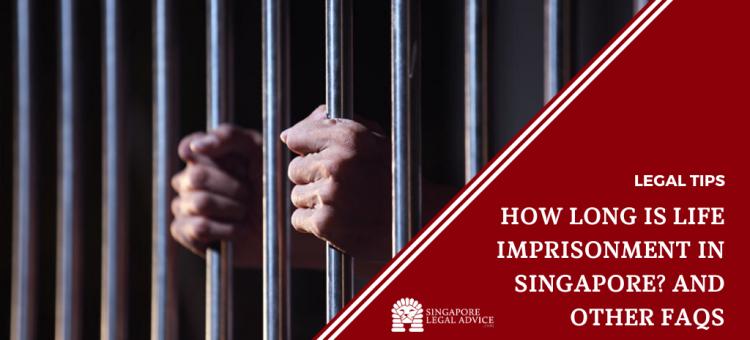 man holding onto jail cell bars